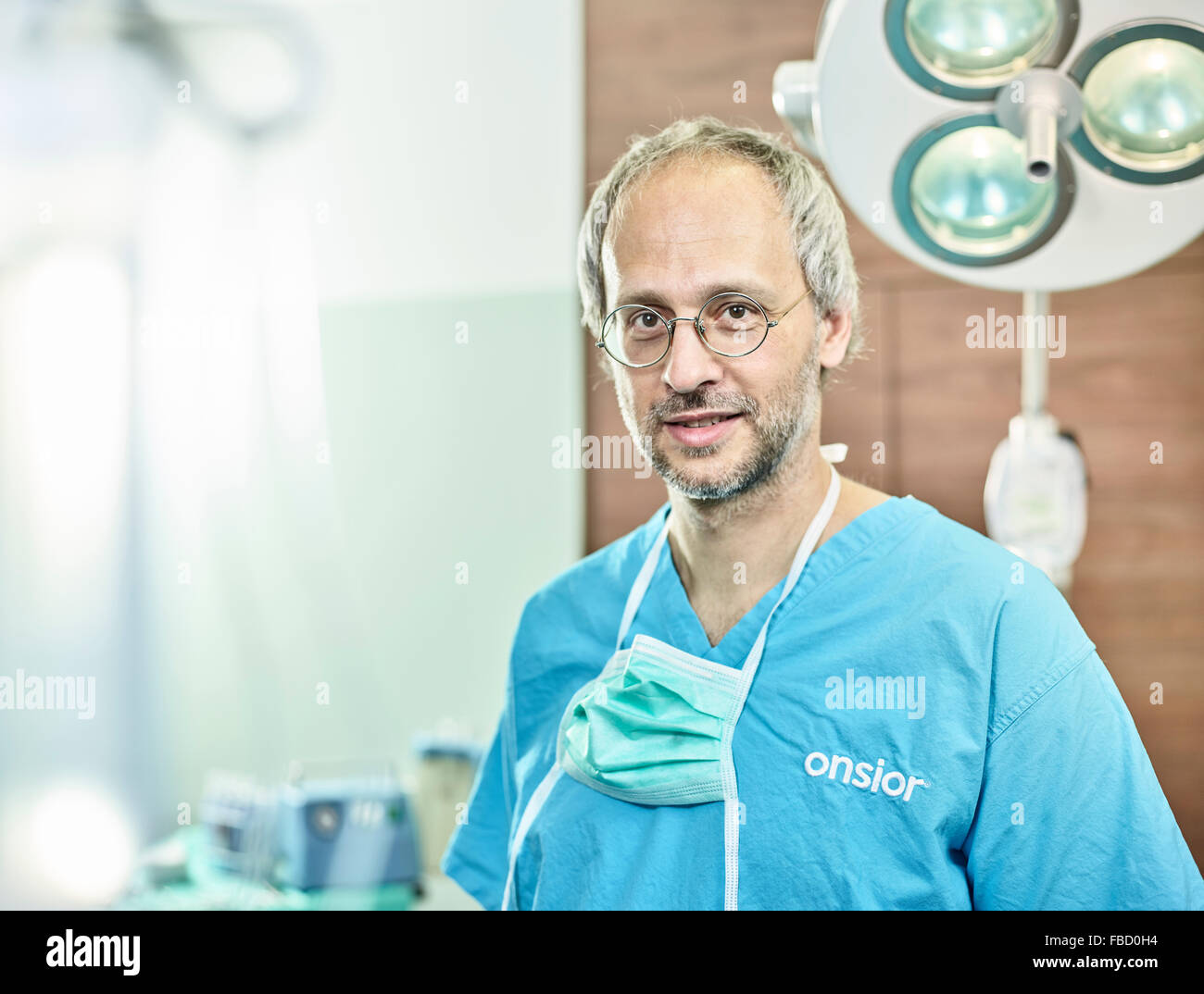 Vet, doctor in operating theatre with face mask around neck, Austria - Stock Image