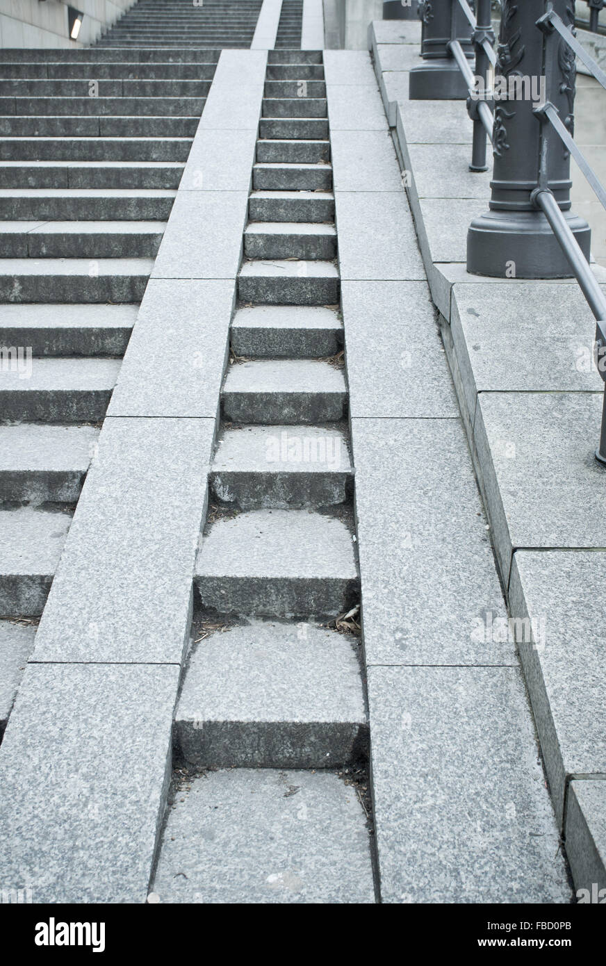 A Set Of Stone Steps In Germany With A Ramp For Wheelchairs And Pushchairs