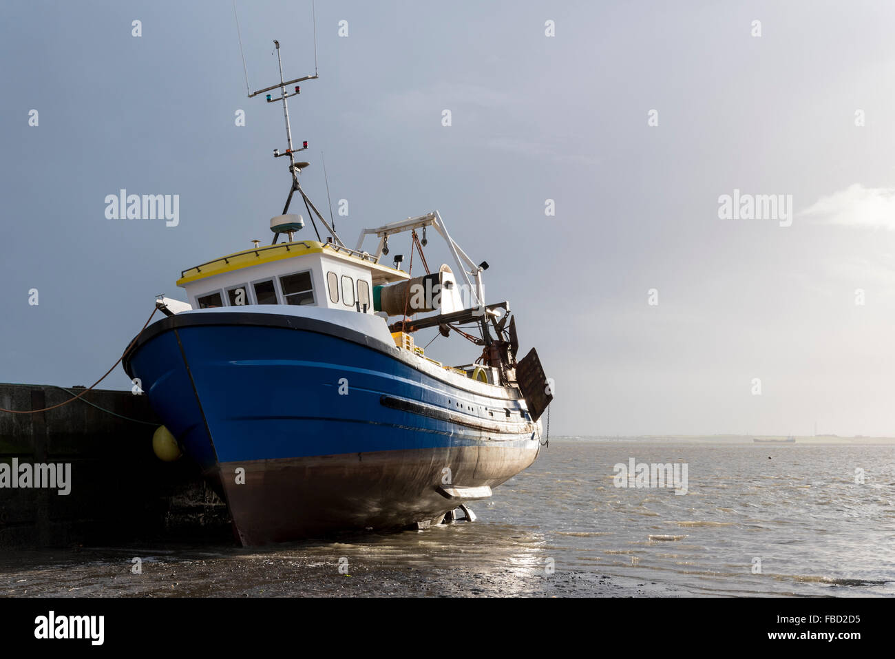 A fishing boat moored at the quayside at Leigh on Sea, Essex - Stock Image