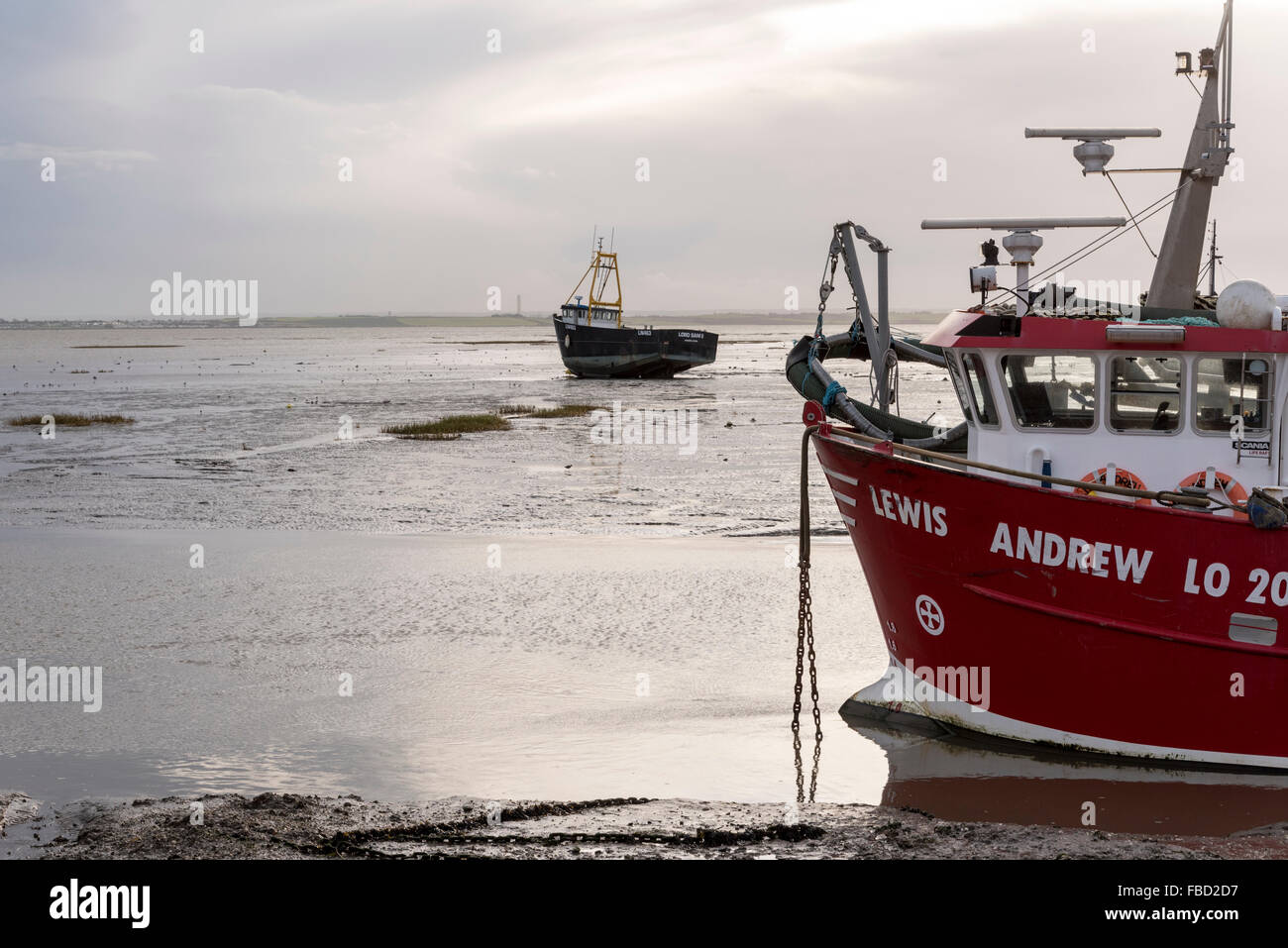 Fishing boats at low tide at Leigh on Sea, Essex - Stock Image