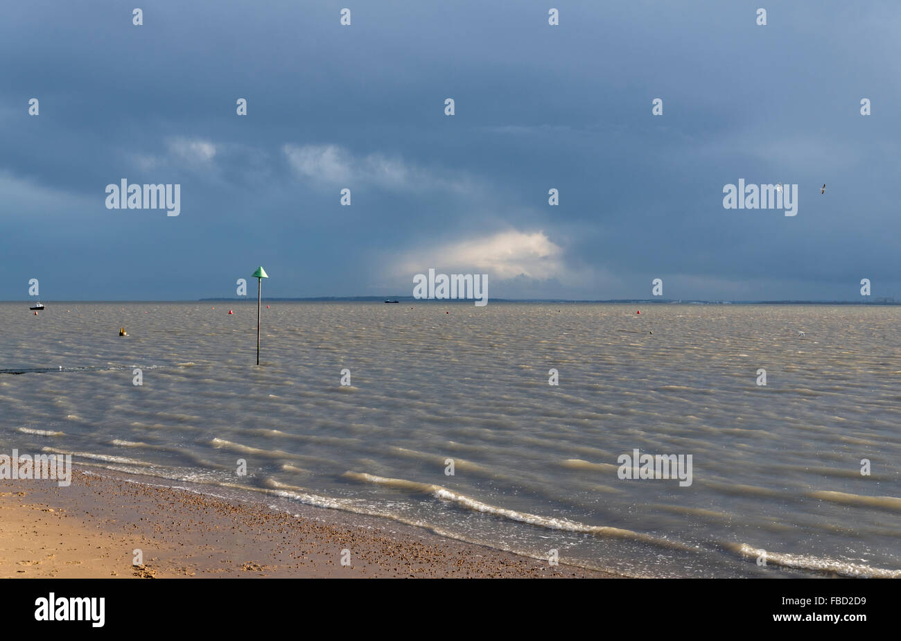 Grey clouds over the Thames Estuary as seen on a winter's day from Leigh on Sea, Essex - Stock Image