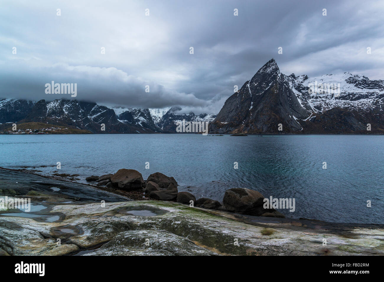 The coast of Hamnøy with Mount Olstinden, Lofoten, Norway Stock Photo