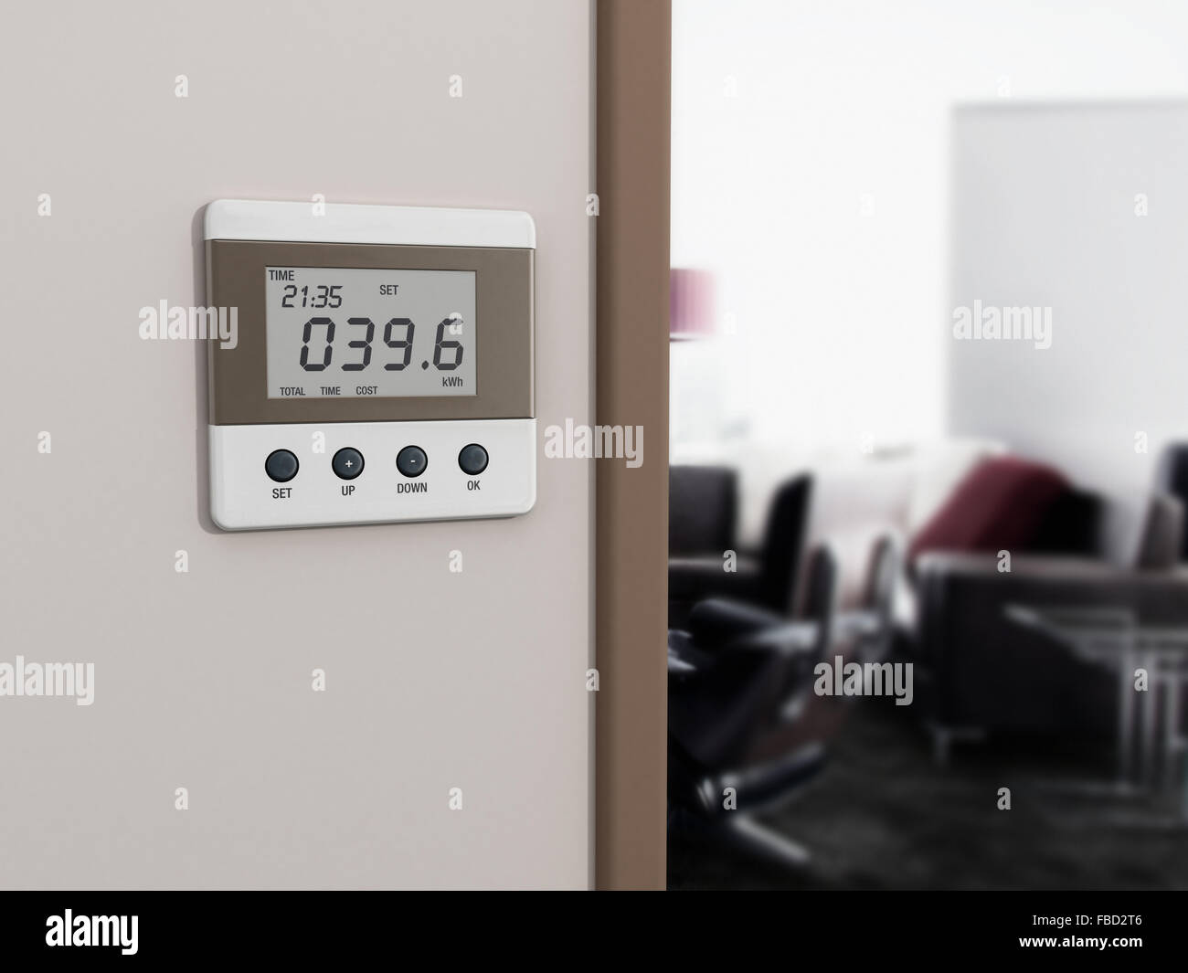 Wall mounted energy meter beside the room entrance. - Stock Image