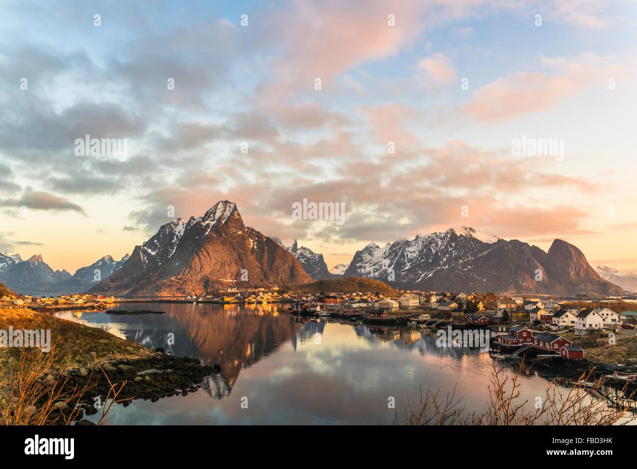 Olstinden mountain at sunrise, Reine, Lofoten, Norway - Stock Image