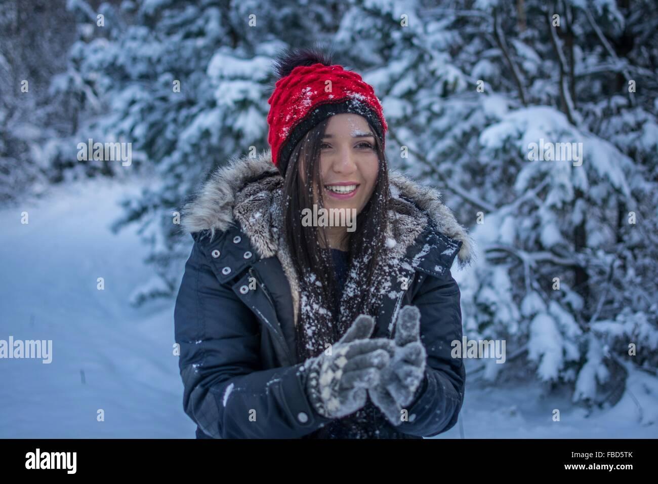 Woman Wearing Winter Gear In Snow Stock Photo
