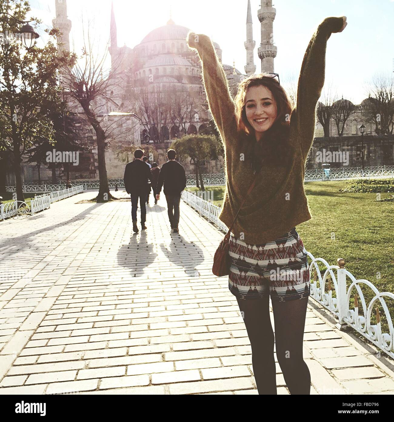 Portrait Of Young Woman, Mosque In Background - Stock Image