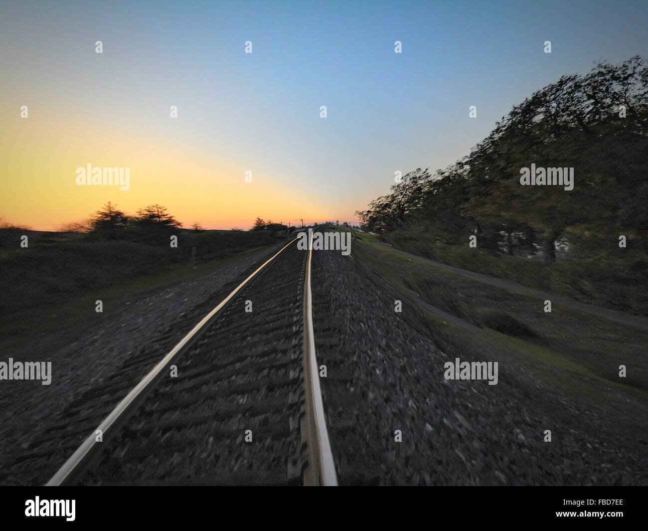 Railroad Track On Field Against Sky - Stock Image