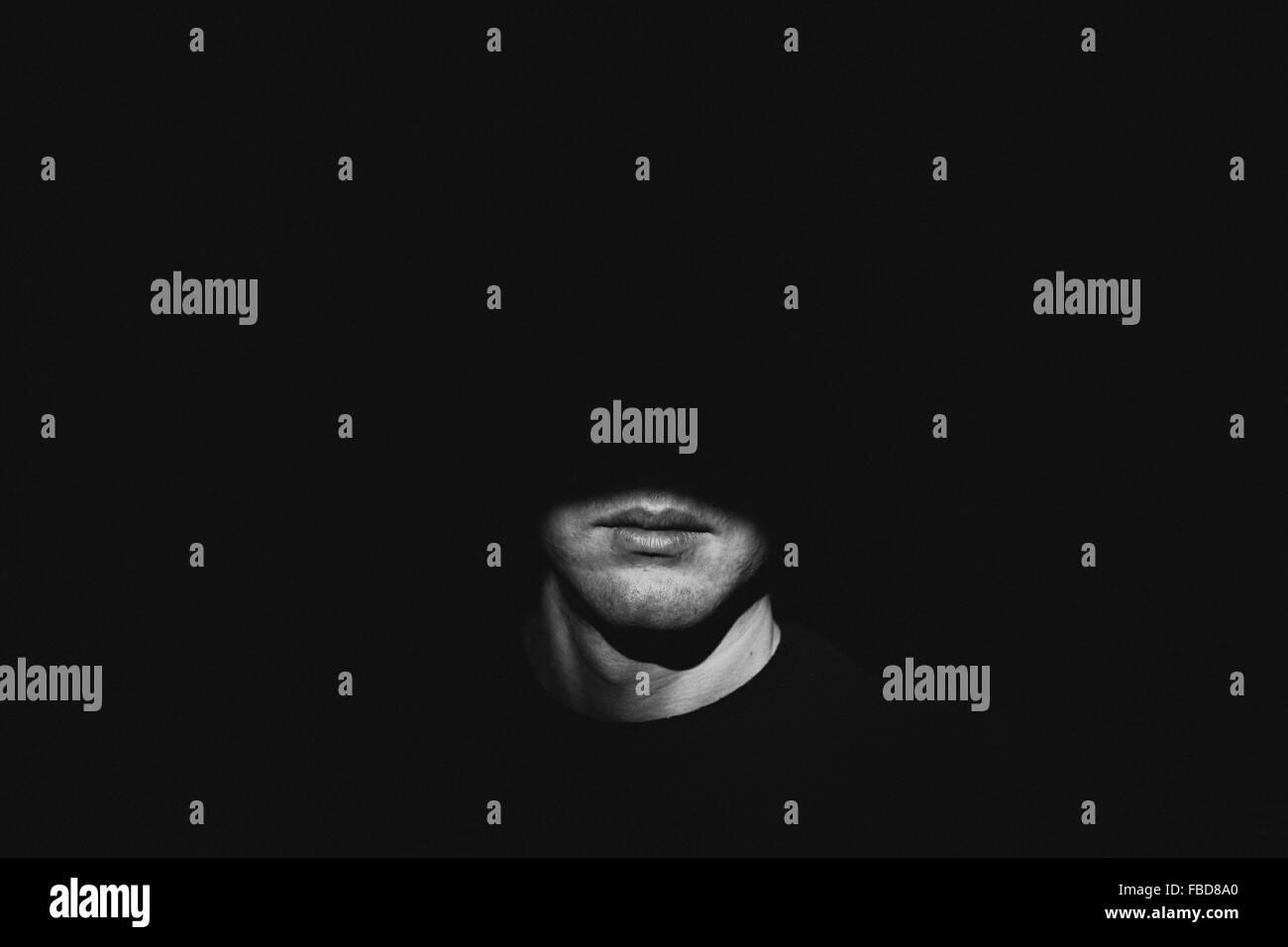 Sunlight Falling On Man In Darkroom - Stock Image
