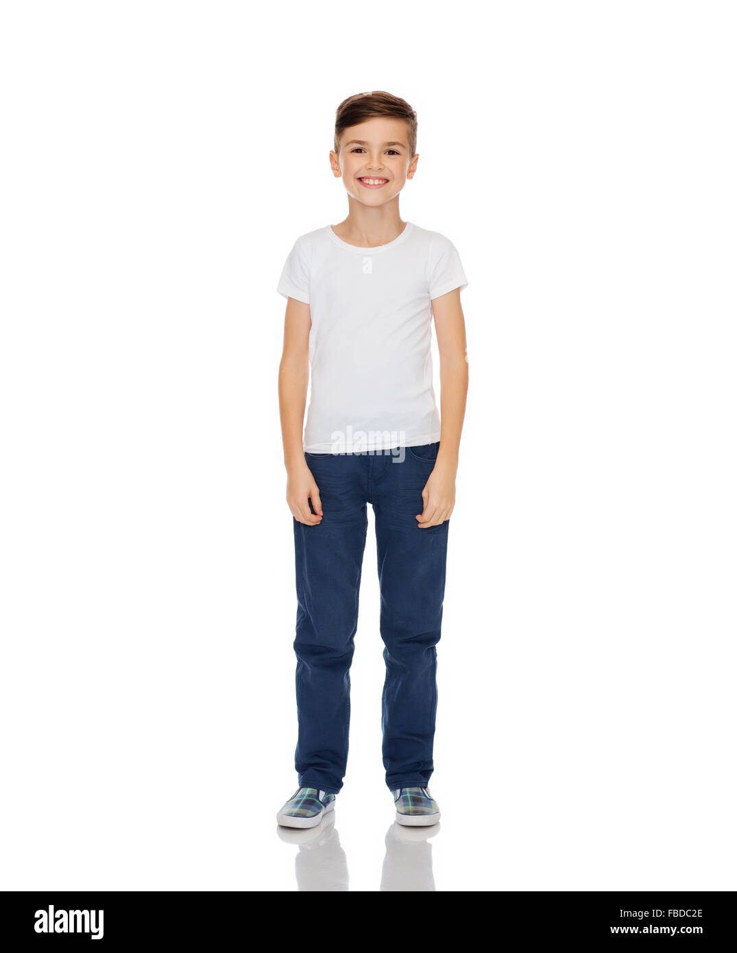 happy boy in white t-shirt and jeans - Stock Image