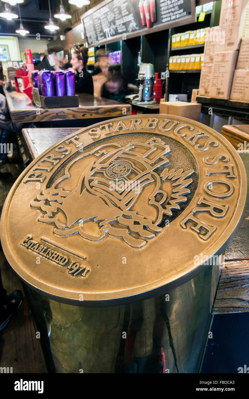 Plaque celebrating the first Starbucks store established in 1971 at Pike Place Market, Seattle, Washington, USA - Stock Image