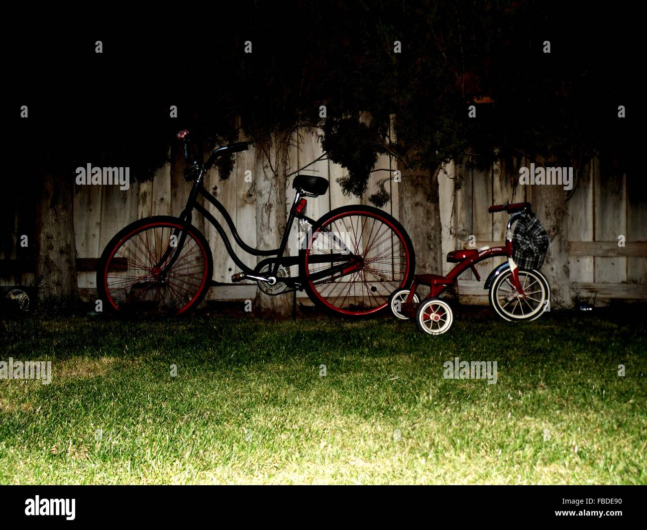 Bicycles By Fence At Park - Stock Image
