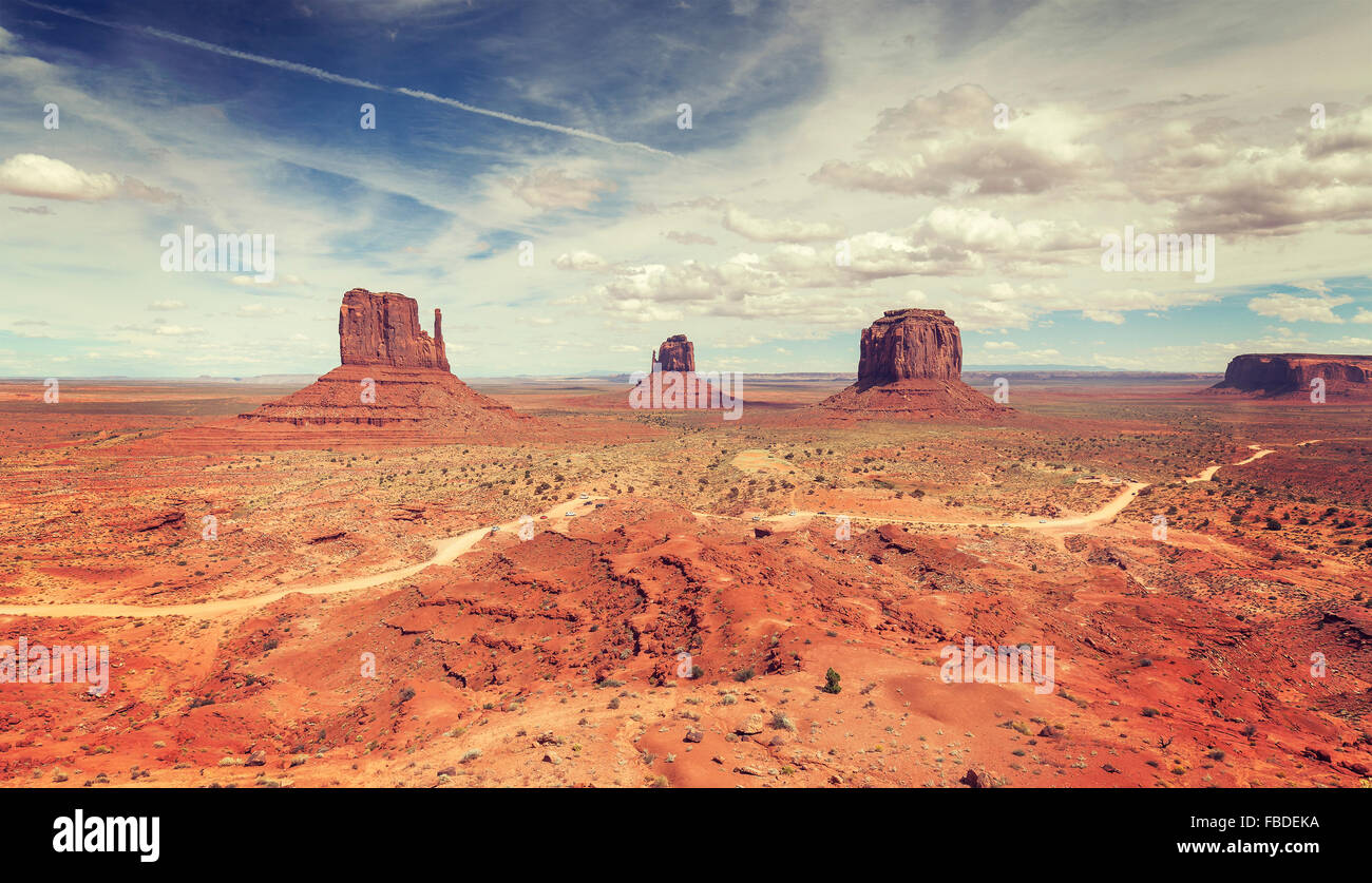 Vintage stylized panoramic view of Monument Valley, USA. - Stock Image