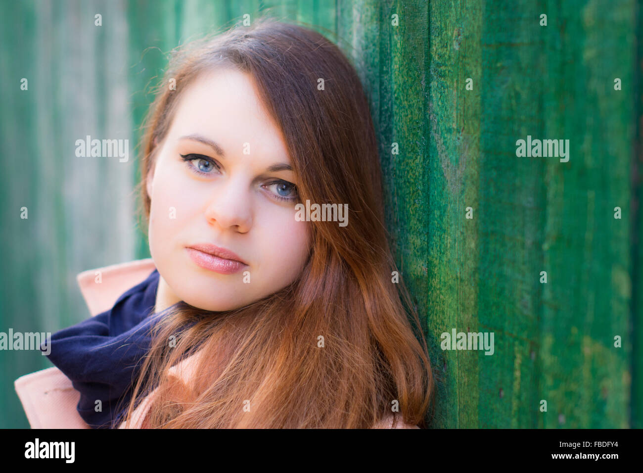 Close-Up Portrait Of A Serious Young Woman - Stock Image