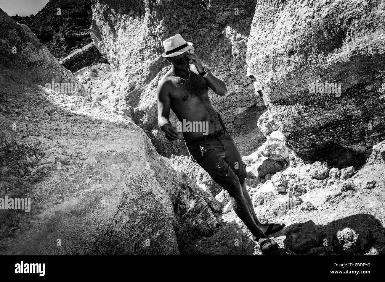 Full Length Of A Man Standing Amid Rocks - Stock Image