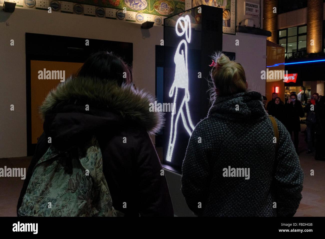 Shaida Walking, 2015 by Julian Opie on display in Broadwick street, off Carnaby Street, London, UK - Stock Image