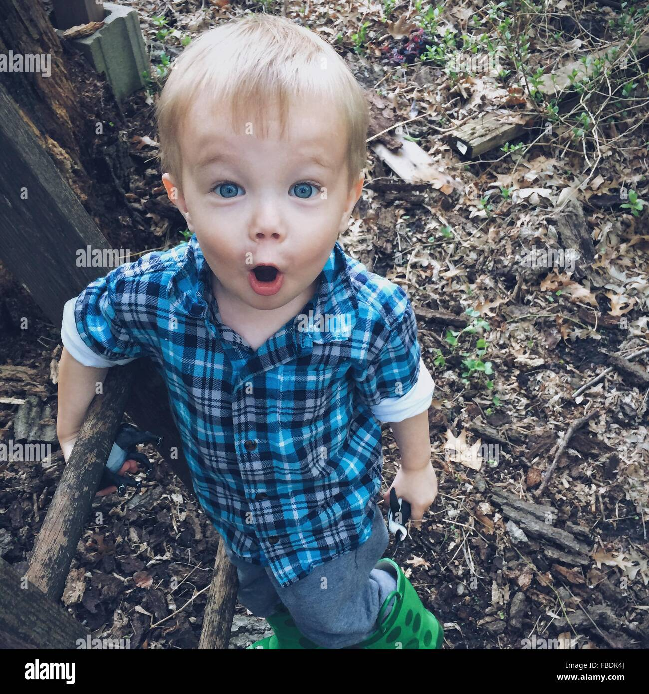 Boy With Mouth Open Looking Shocked - Stock Image