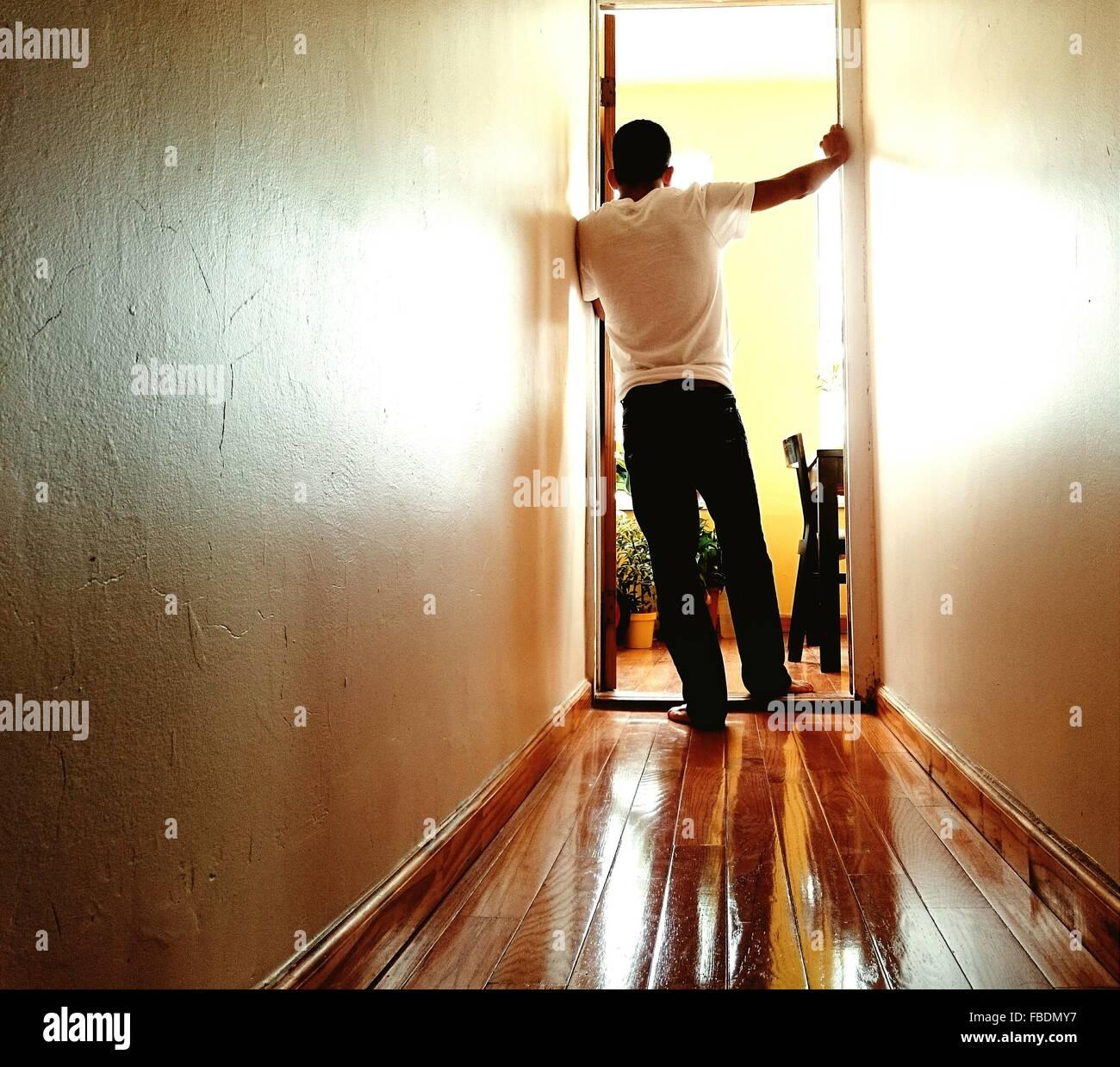Man Standing At Doorway - Stock Image