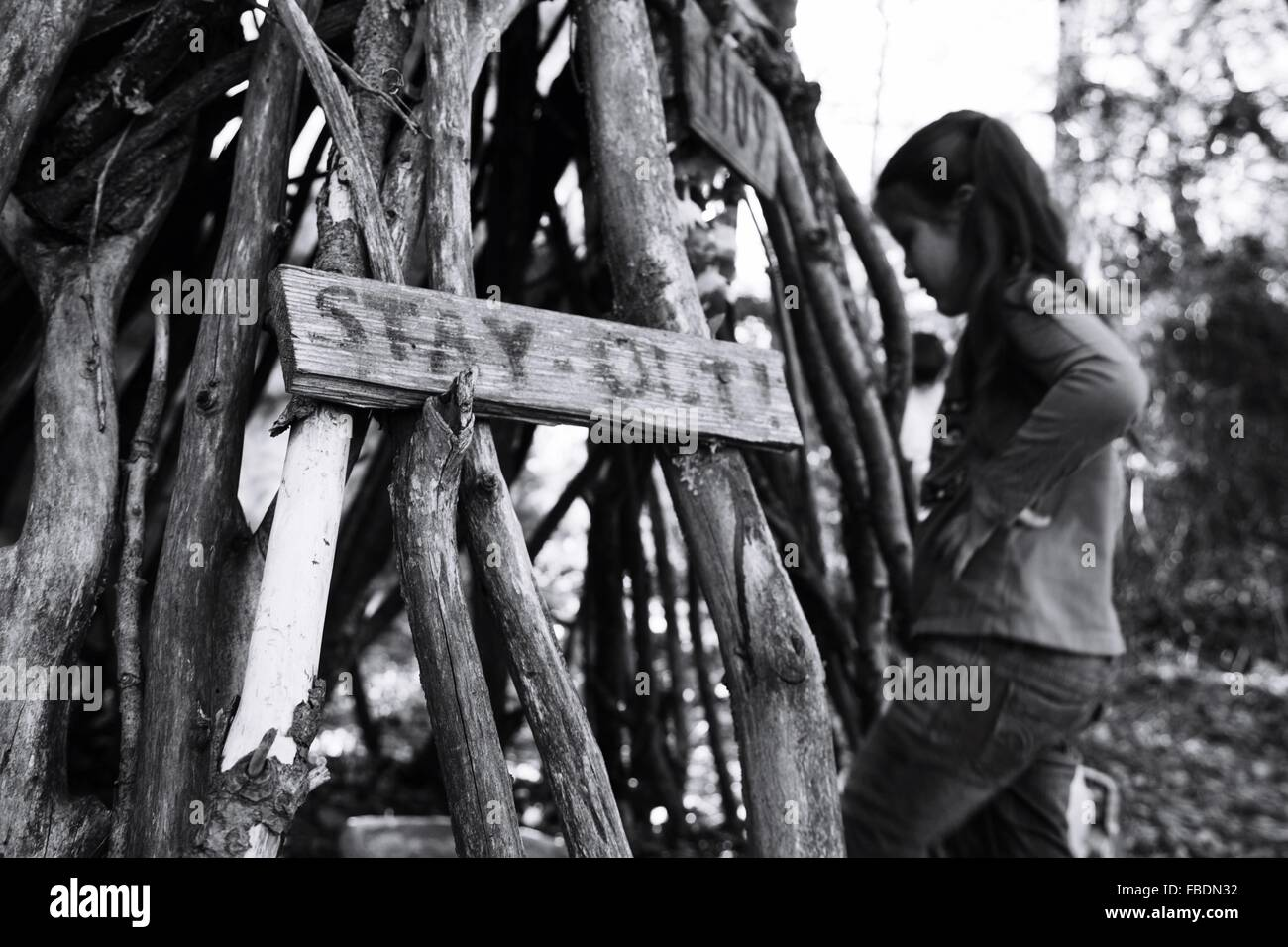 Girl Near Pile Of Wood - Stock Image