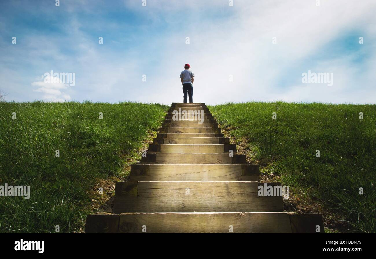 Boy Standing On Steps - Stock Image