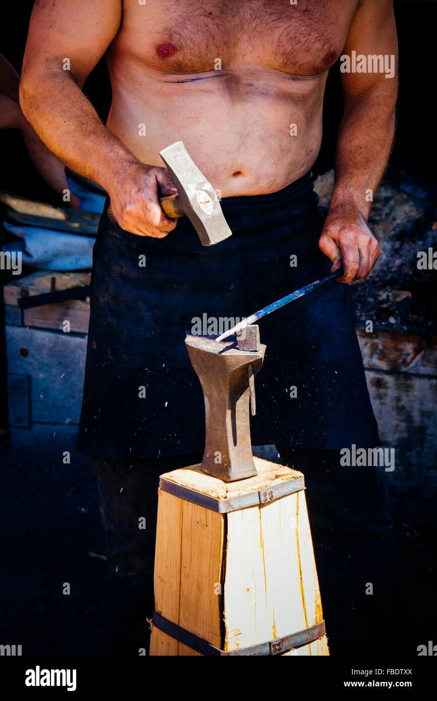 Iron Worker With Hammer And Anvil Stock Photo: 93118002 - Alamy