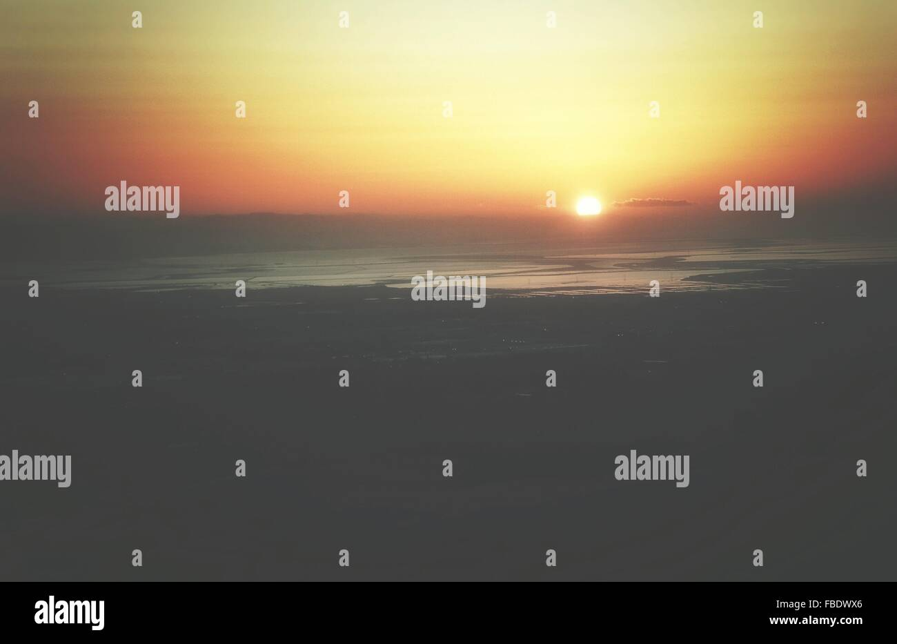Scenic View Of Beach Against Sky At Sunset - Stock Image