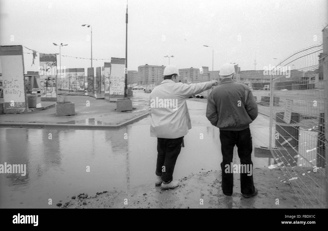 Two workmen survey the former no-mans-land at Potsdamer Platz, berlin, prior to extensive redevelopment. Parts of - Stock Image
