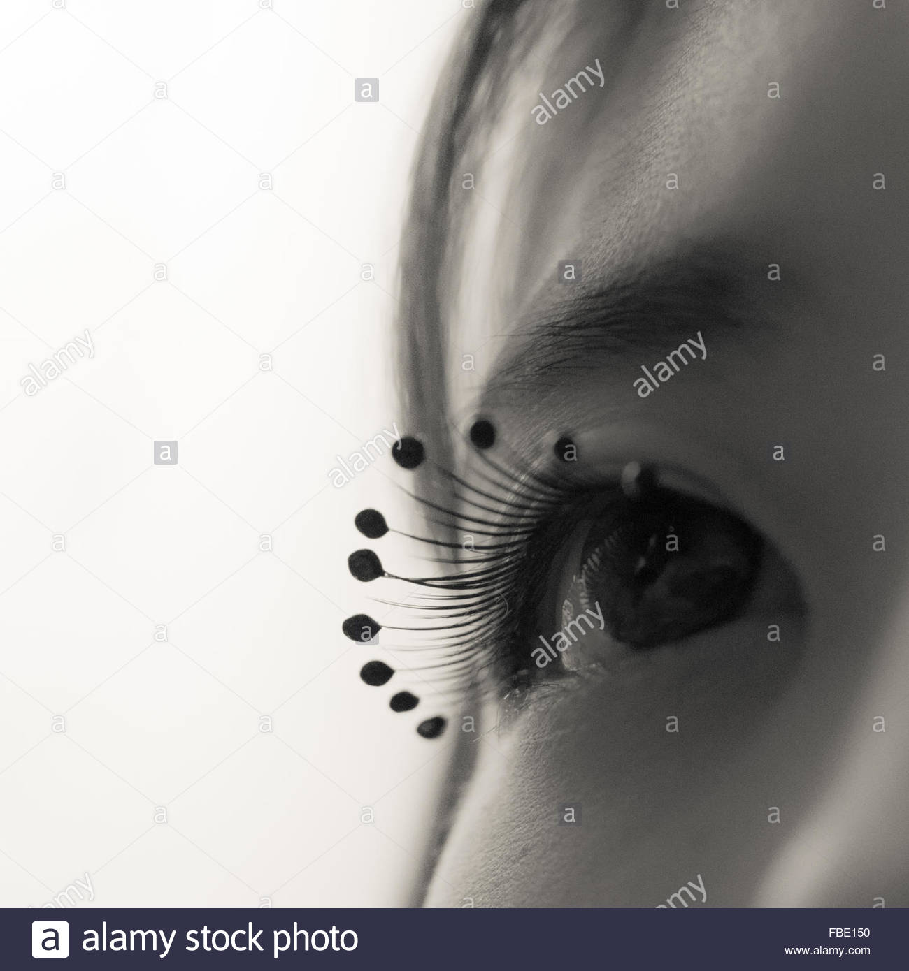 Close-Up Of Woman Wearing Droplet Beads Eyelash Stock Photo
