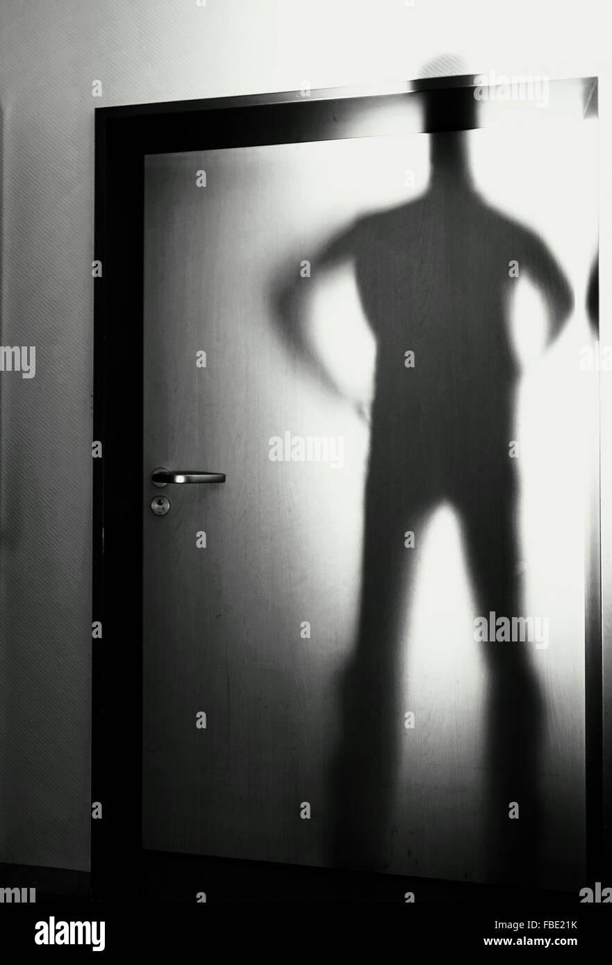 Shadow Of Man On House Door - Stock Image