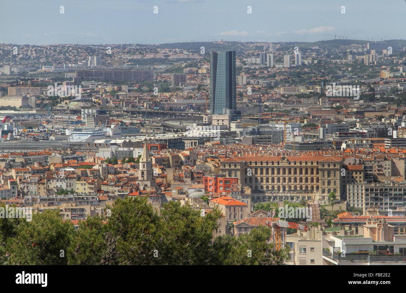 Cma Cgm Tower Against Sky Amidst City - Stock Image