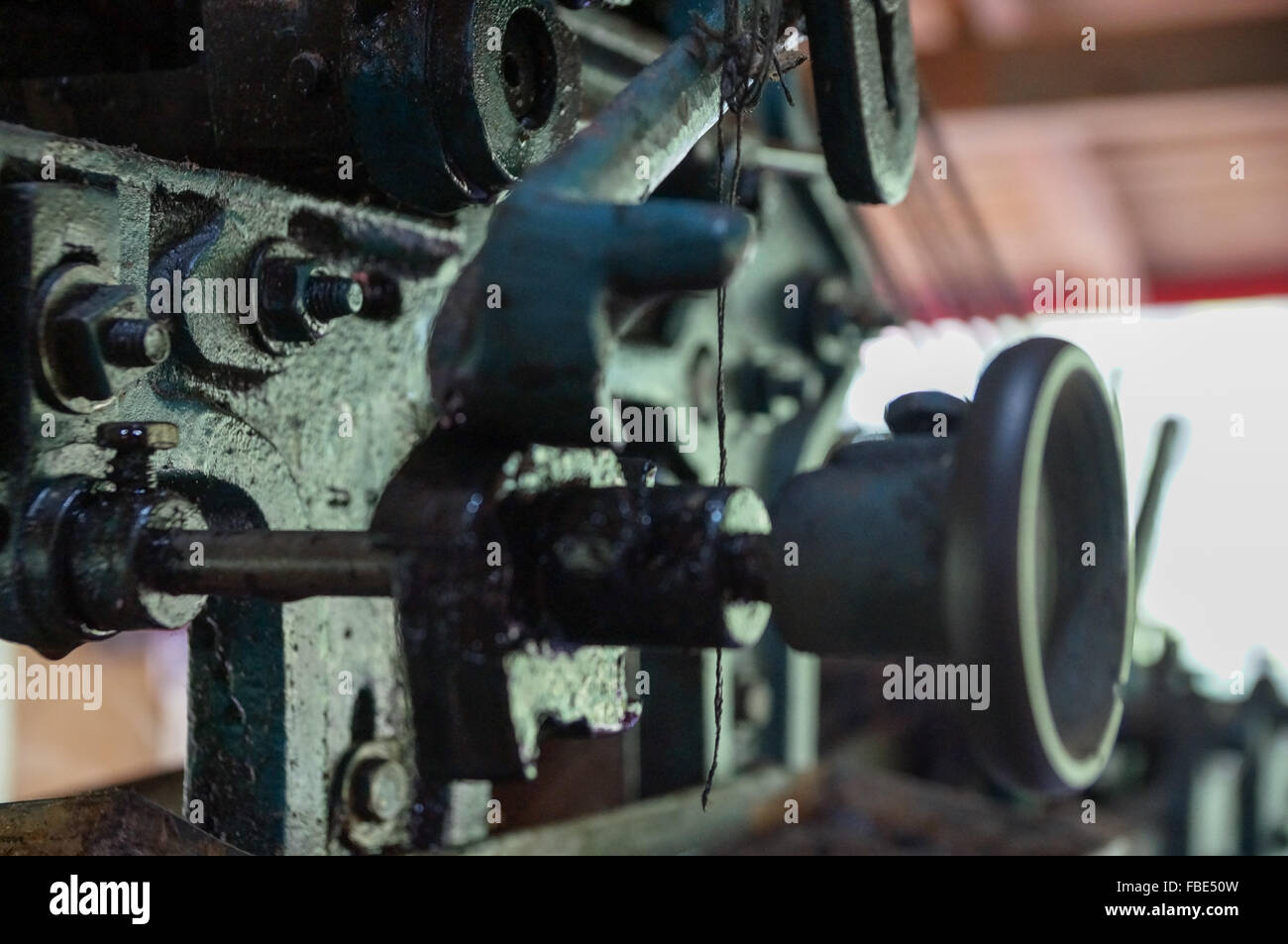 Close-Up Of Machinery At Textile Factory - Stock Image