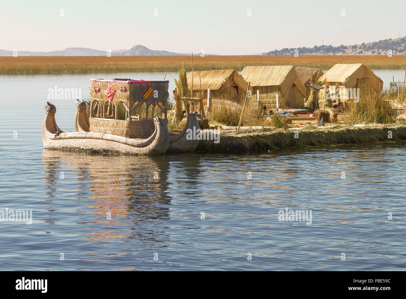 Reed boat on Island of Uros. Those are floating islands on lake Titicaca located between Peru and Bolivia. Colorful Stock Photo
