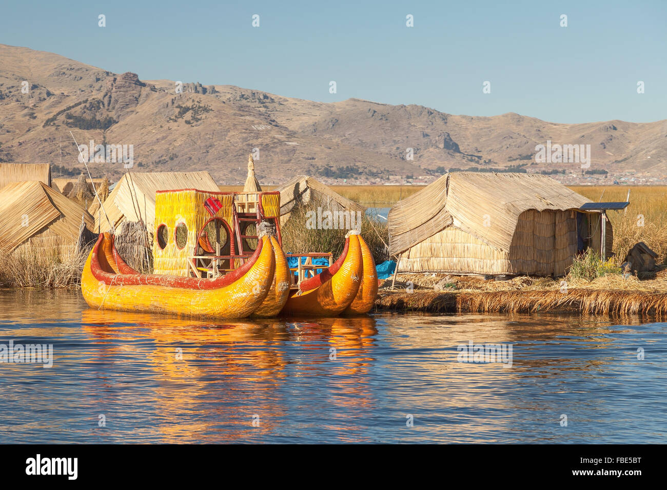 Reed boat on Island of Uros. Those are floating islands on lake Titicaca located between Peru and Bolivia. Colorful - Stock Image