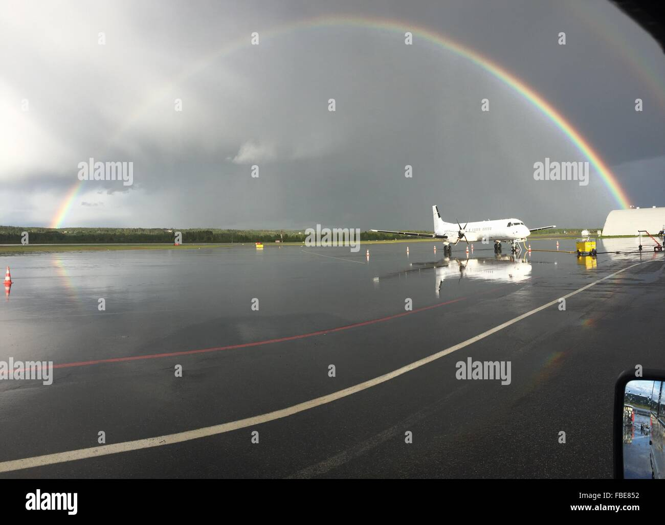 View Of Rainbow Over Calm Sea - Stock Image