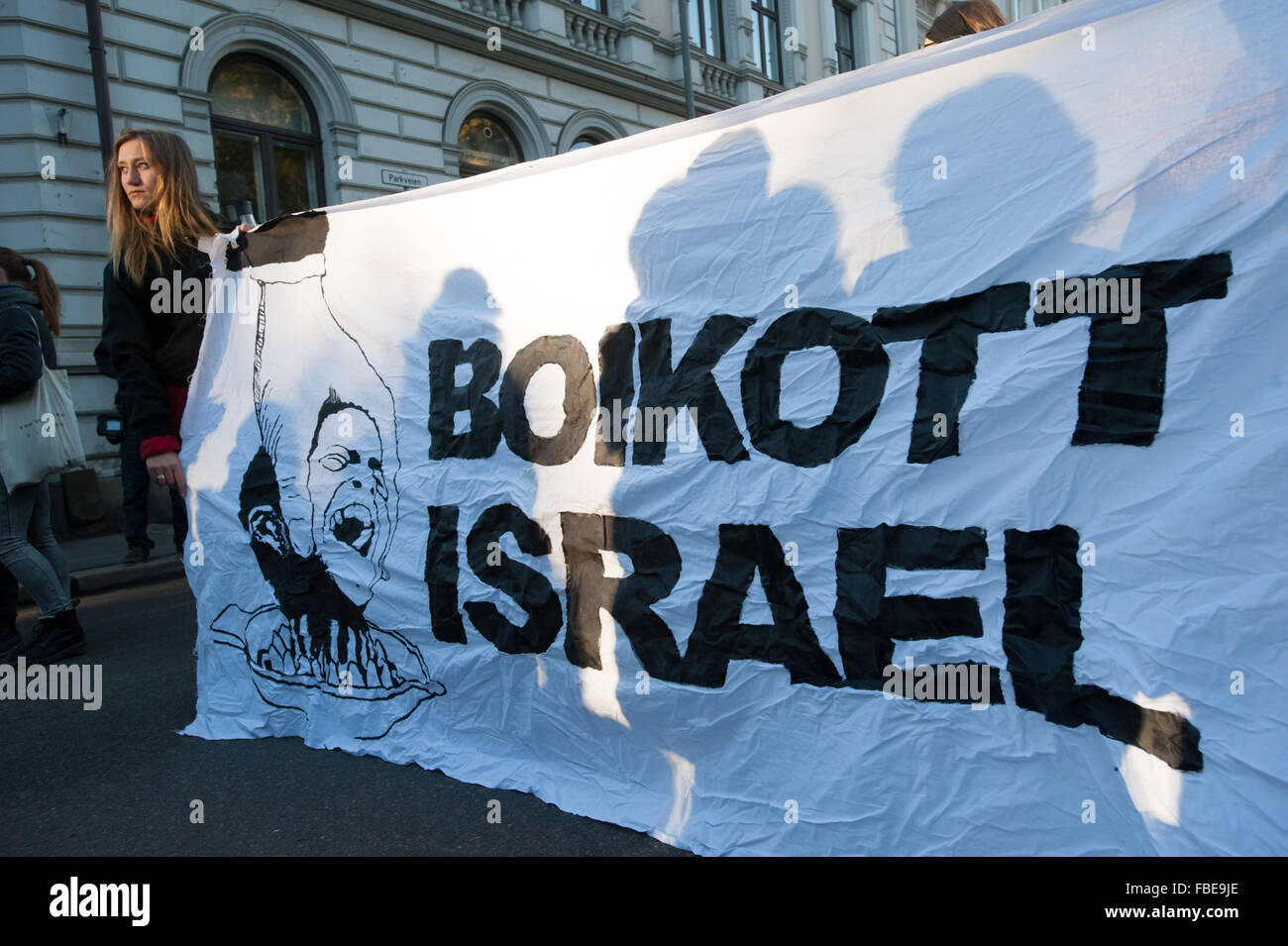 Activists hold a banner reading 'Boycott Israel' during a protest in solidarity with Palestine  near the - Stock Image