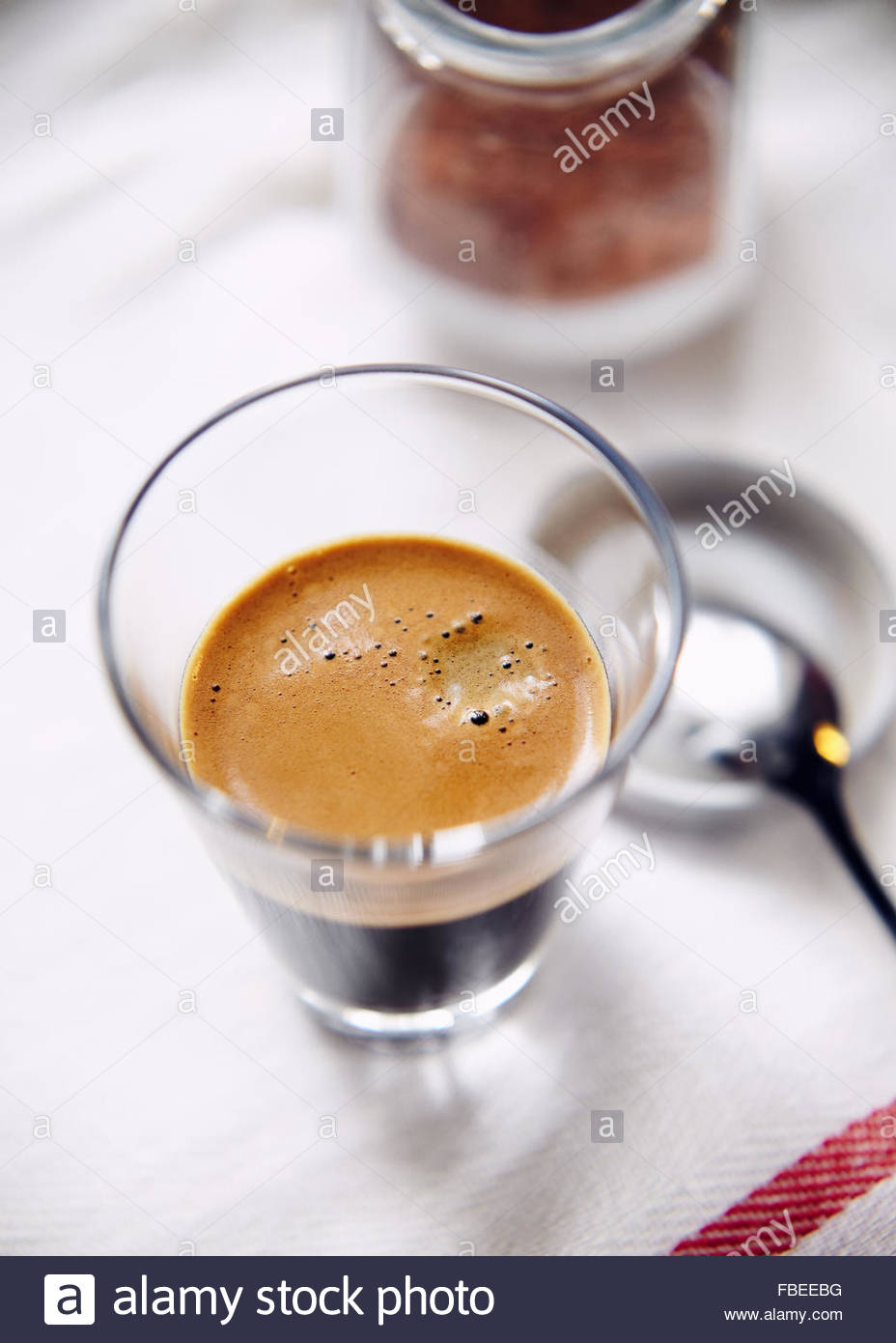 Glass cup of espresso overhead - Stock Image