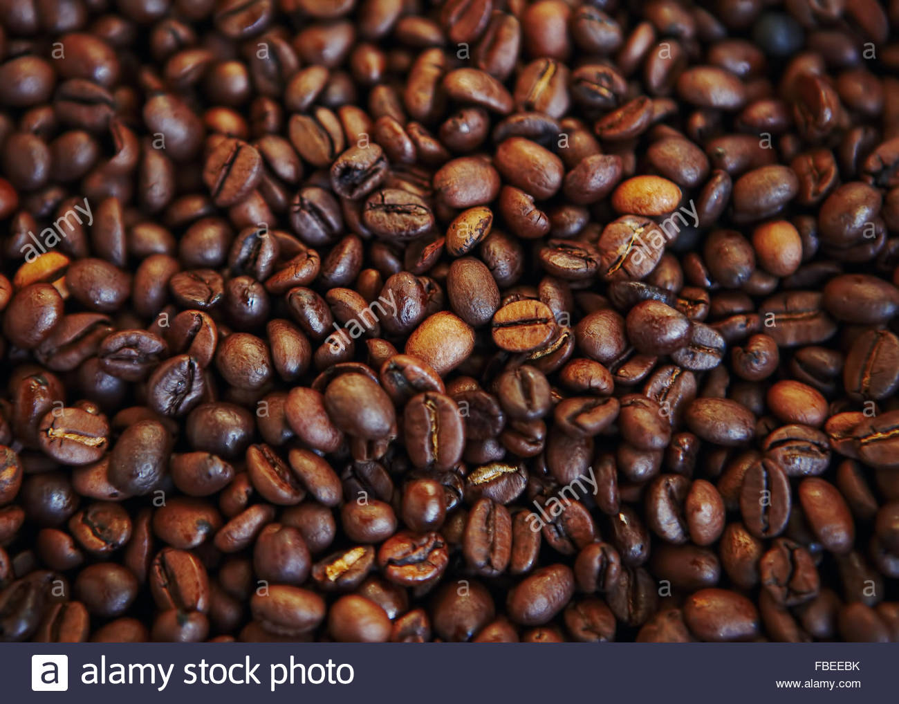 Roasted coffee bean pile - Stock Image