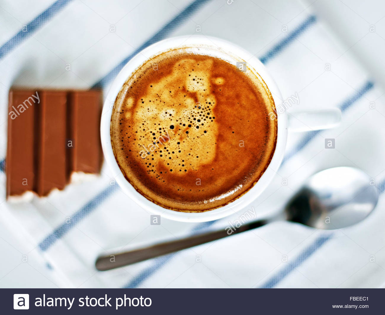 A cup of espresso on a striped towel - Stock Image