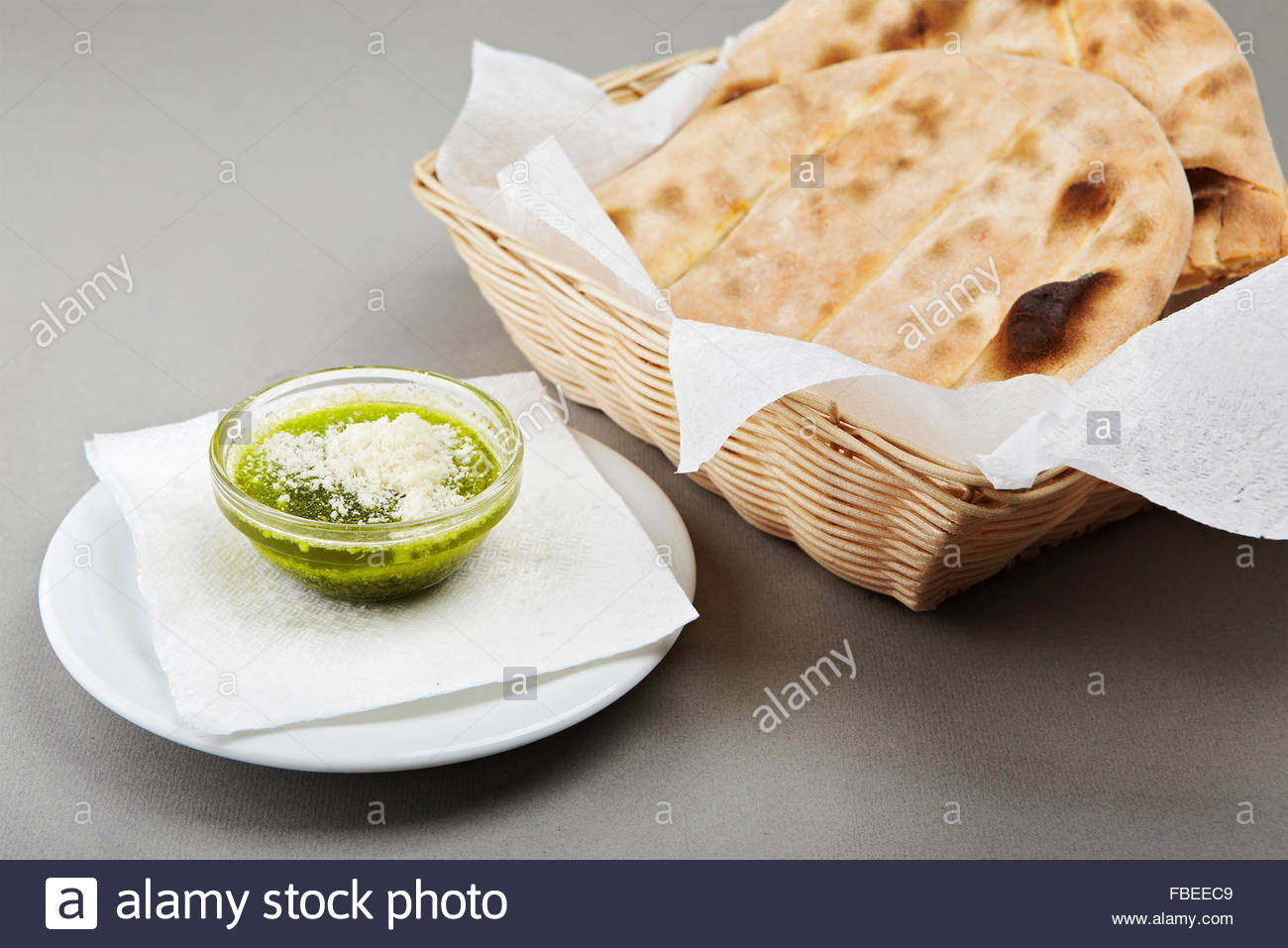 Chiabatta and pesto on grey background - Stock Image