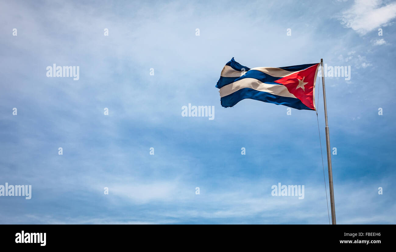 Cuban flag flying in the wind on a backdrop of blue sky. National symbol. - Stock Image