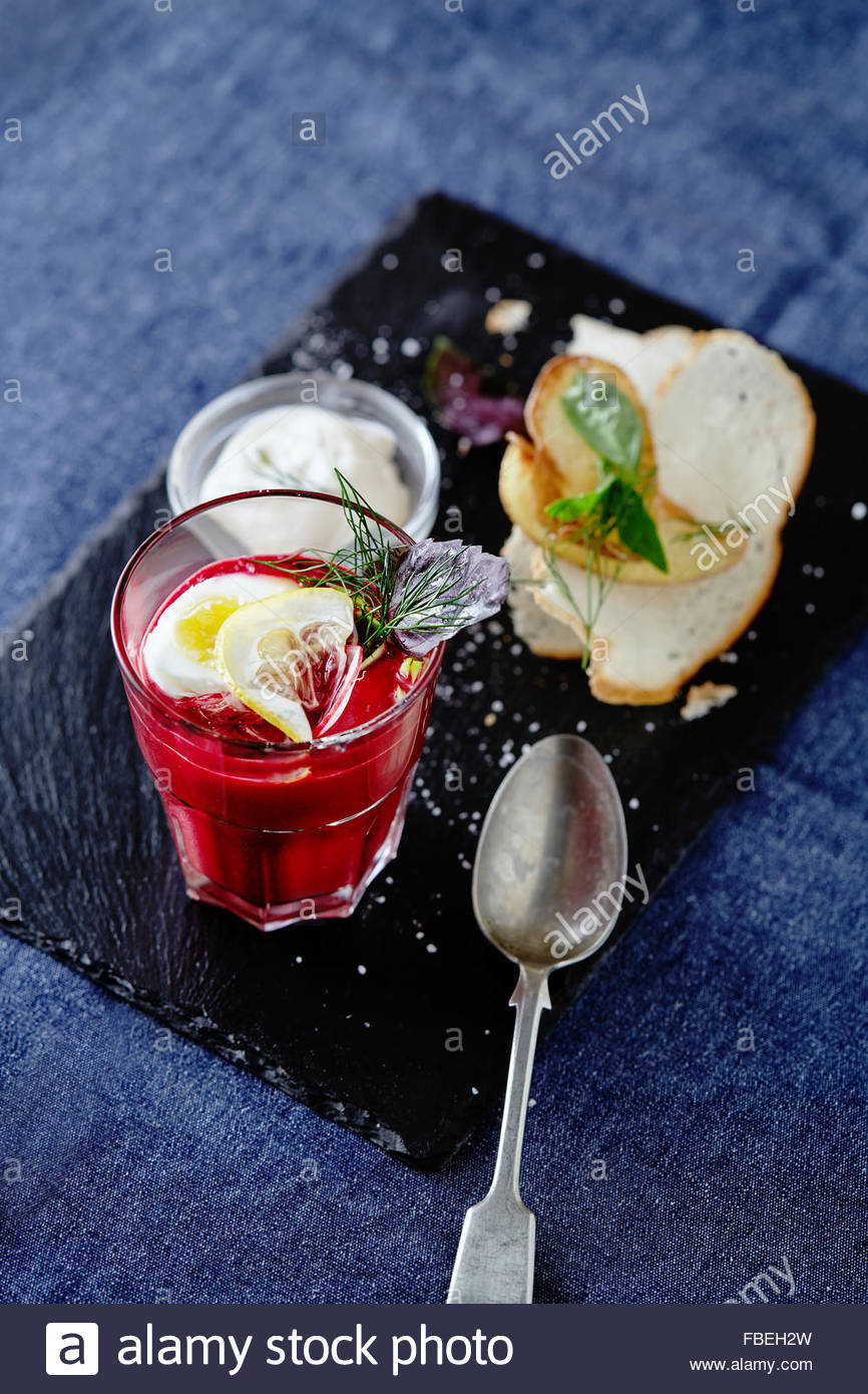 Beetroot soup with poached egg and wheat croutons - Stock Image