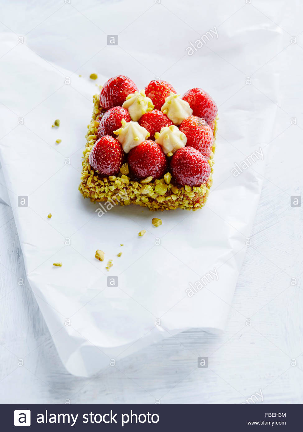 The closeup of strawberry tatalete with pistachios - Stock Image