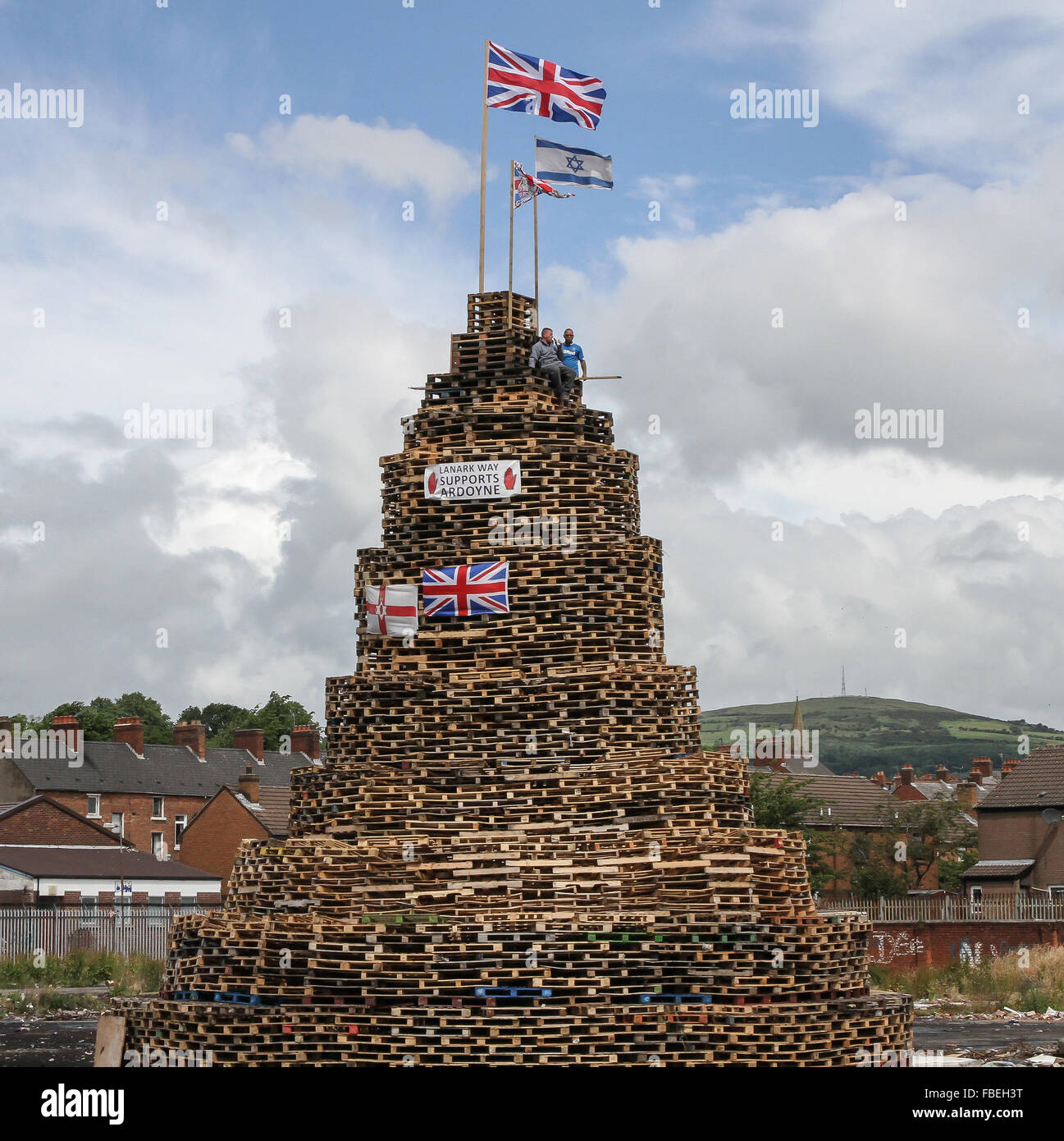 Loyalist bonfire in Lanark Way Belfast. Bonfires are traditionally lit on the 11th July in loyalist areas; history - Stock Image