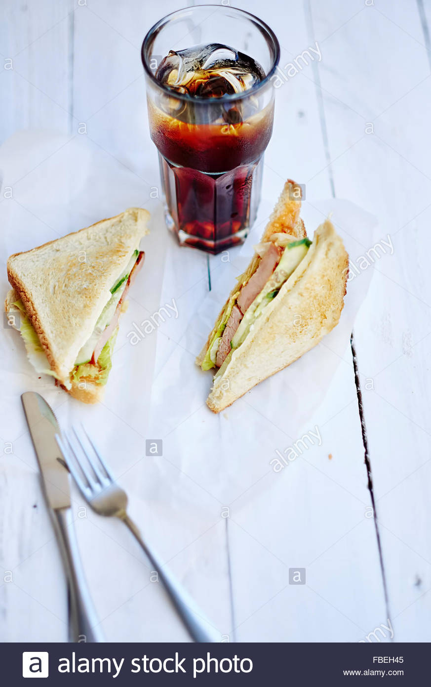 Various sandwiches on table - Stock Image
