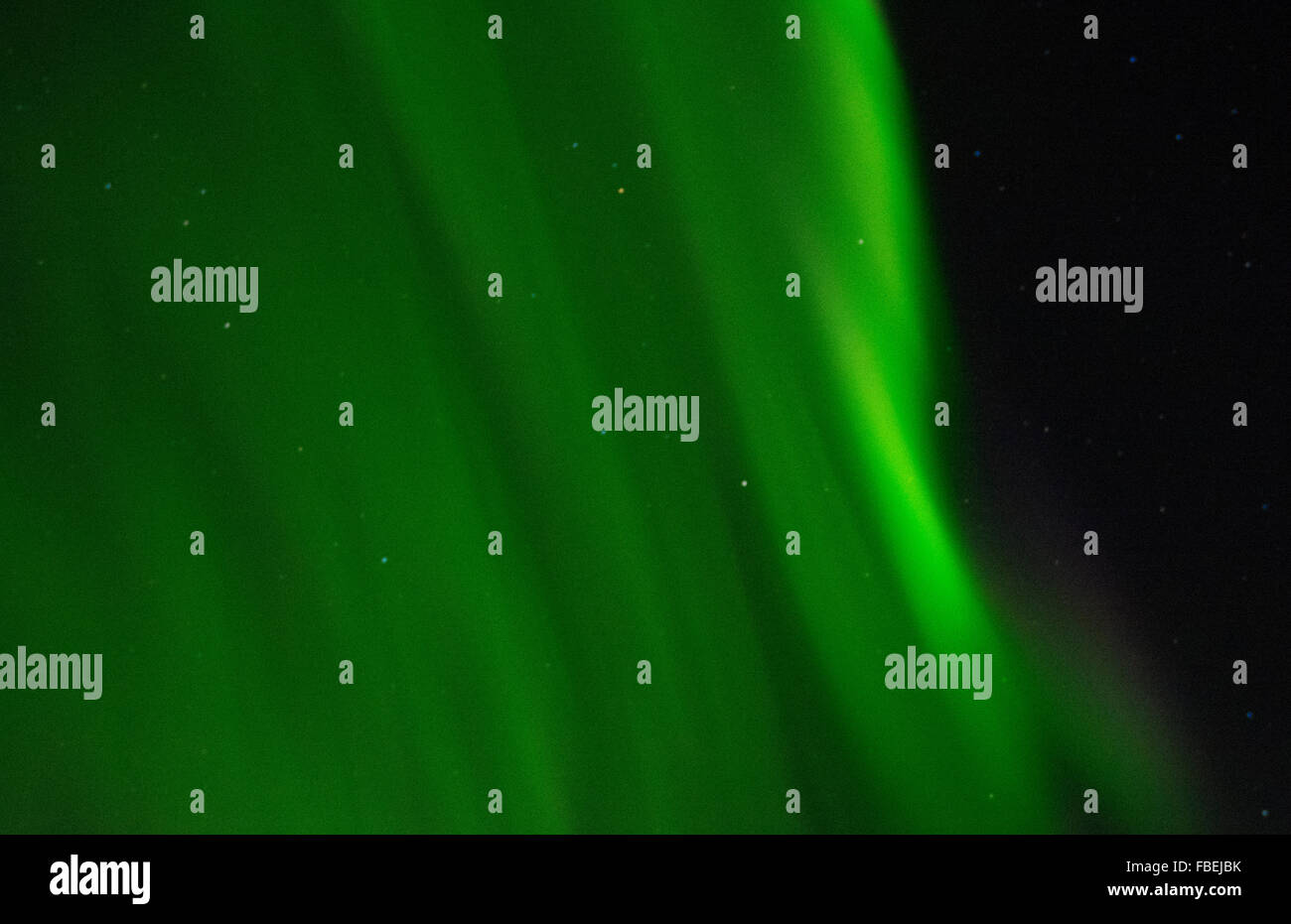 Iceland spectacular Northern Lights green in Reykholt Valley in West Iceland sky lights - Stock Image