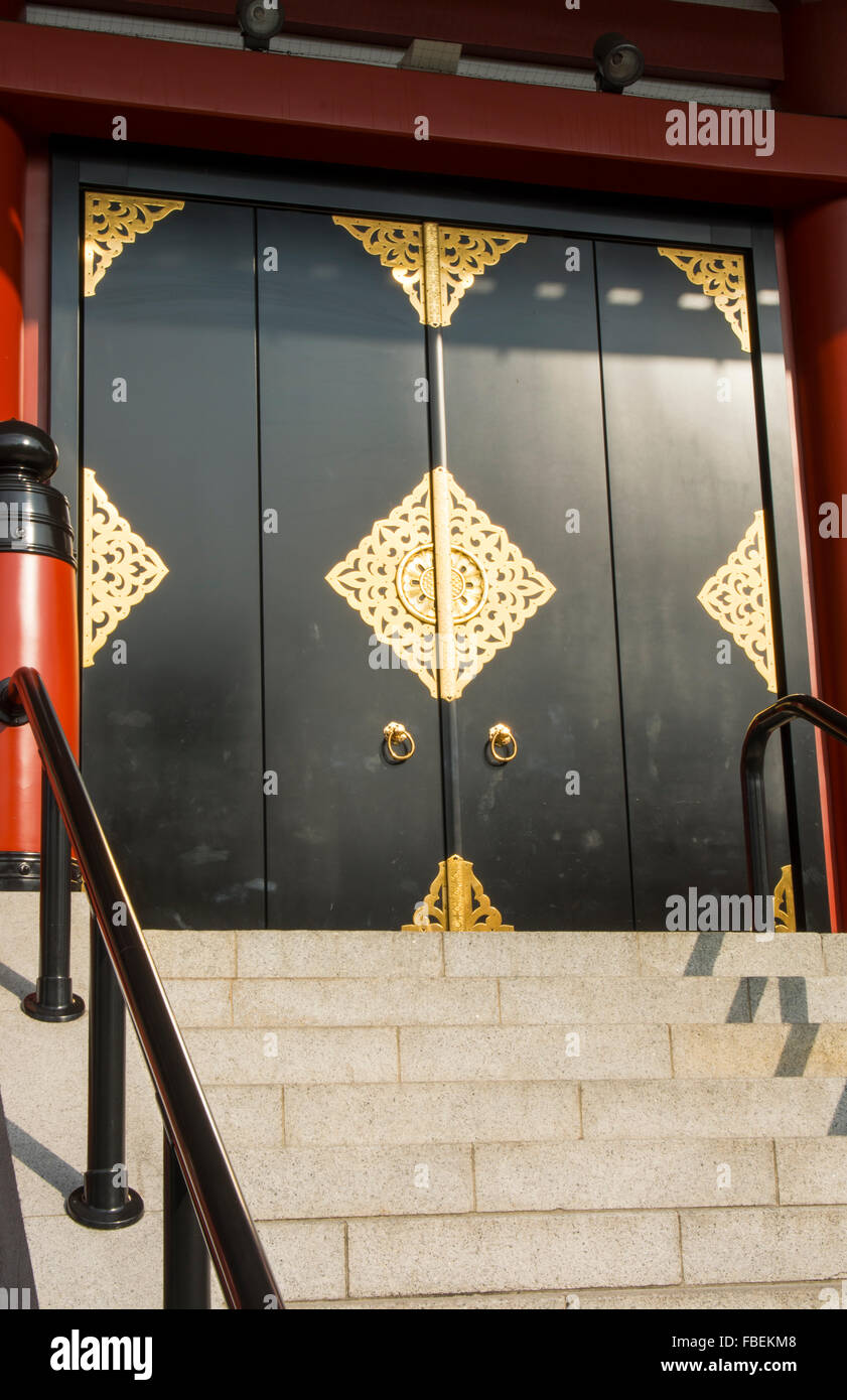Tokyo Japan Sensoji Temple door, gold, black at Tokyo's oldest temple and important built in 645 founded - Stock Image