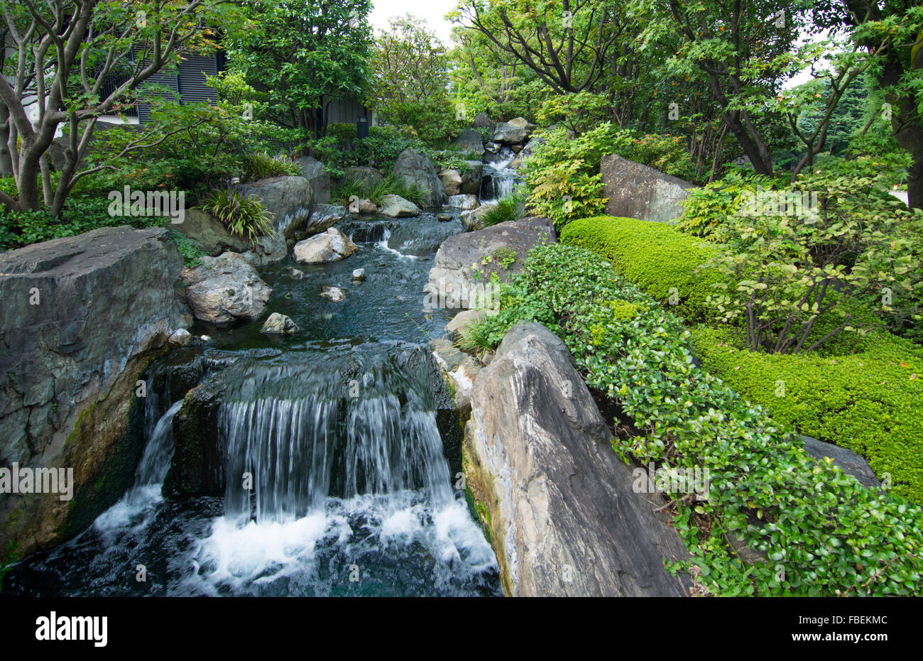 Tokyo Japan quiet area with waterfall at Sensoji Temple at Tokyo's oldest temple with water and rocks and peaceful - Stock Image