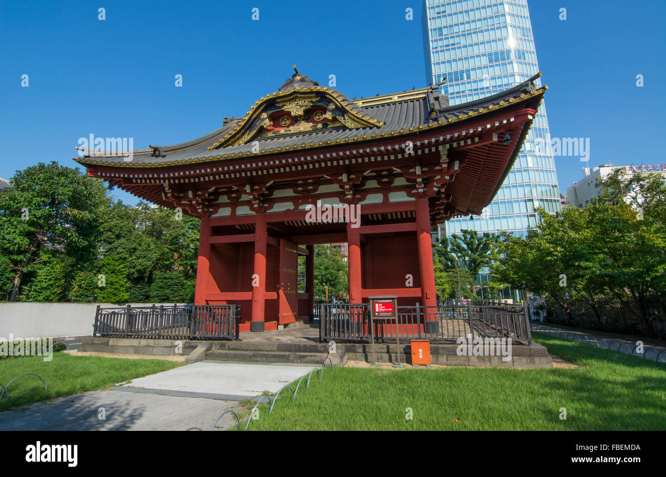 Tokyo Japan gate of Zojo-ji Temple in Shiba neighborhood in downtown city view red historical monument - Stock Image