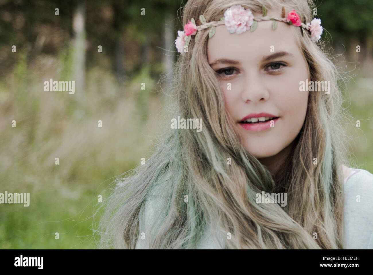 Portrait Of Beautiful Woman At Park - Stock Image