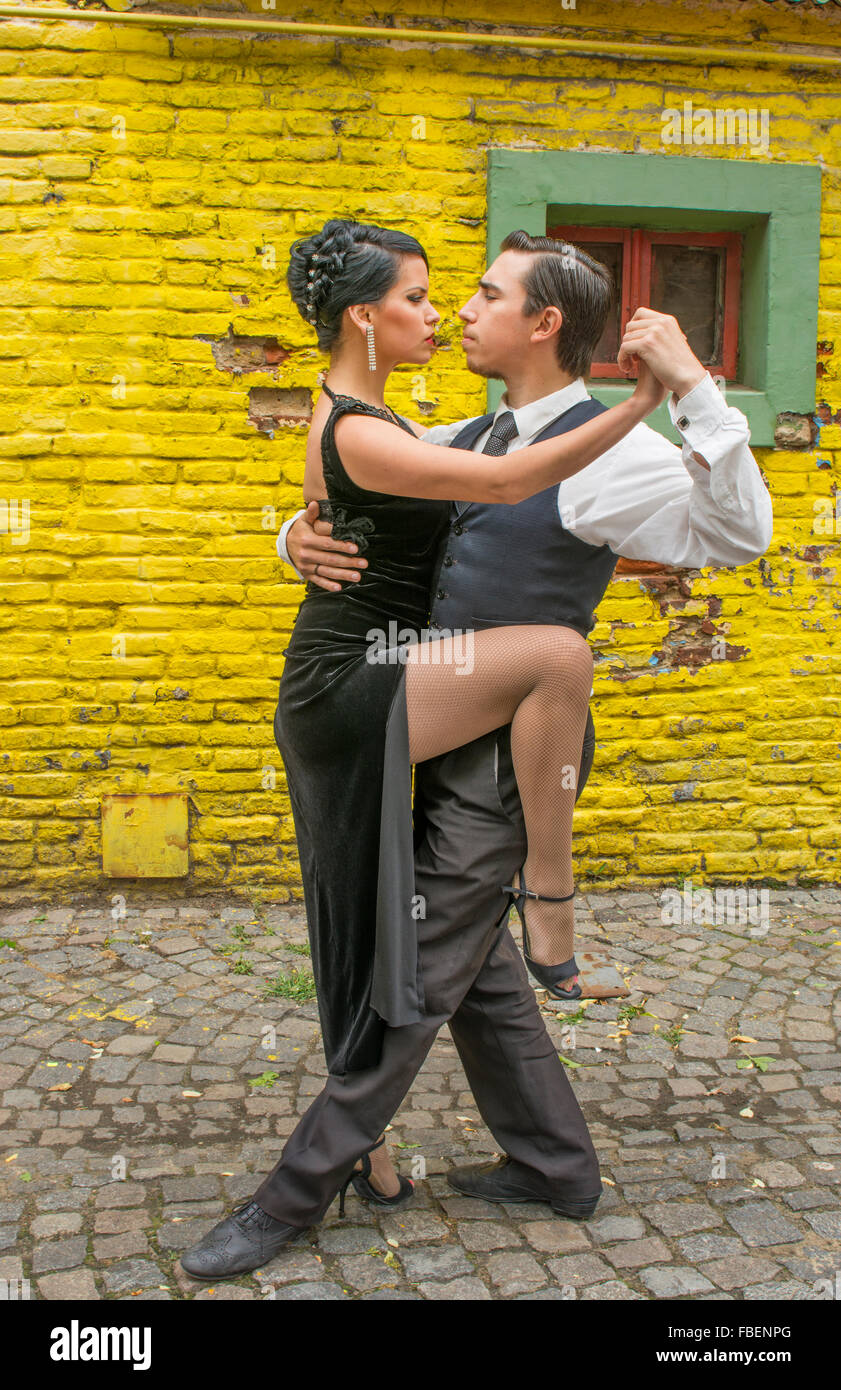Buenos Aires Argentina La Boca tango dance with couple on street with colors worn walls with passion model released - Stock Image