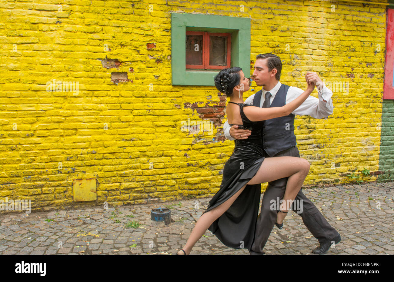 Buenos Aires Argentina La Boca tango dance with couple on street with colors worn walls with passion model released Stock Photo